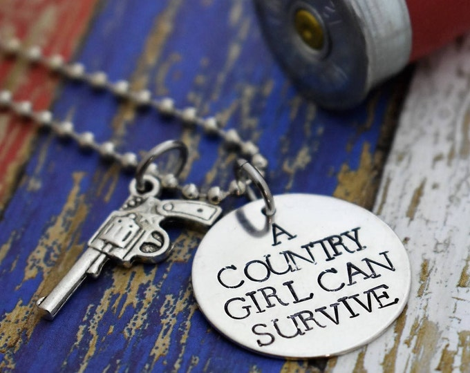 Featured listing image: A Country Girl Can Survive Hand Stamped Necklace with Gun Charm *Hand Stamped Jewelry*Country Girl*Sassy Girl*Gift for Her*Country Life*