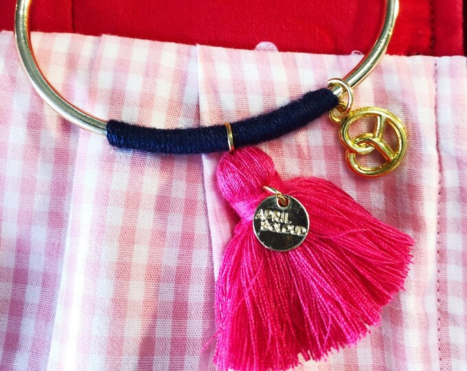 Bangle with shell and pink tassel