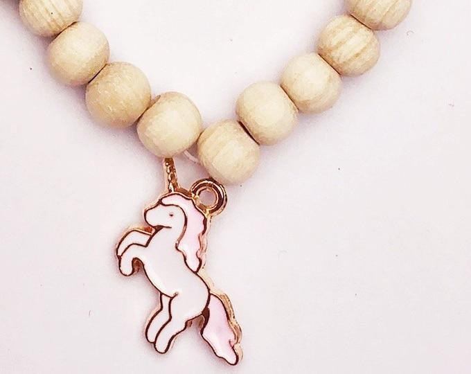 Children's bracelet wooden beads with unicorn pendant enamel