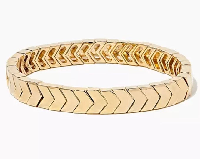 GLOW UP bracelet made of gold enamelled metal beads