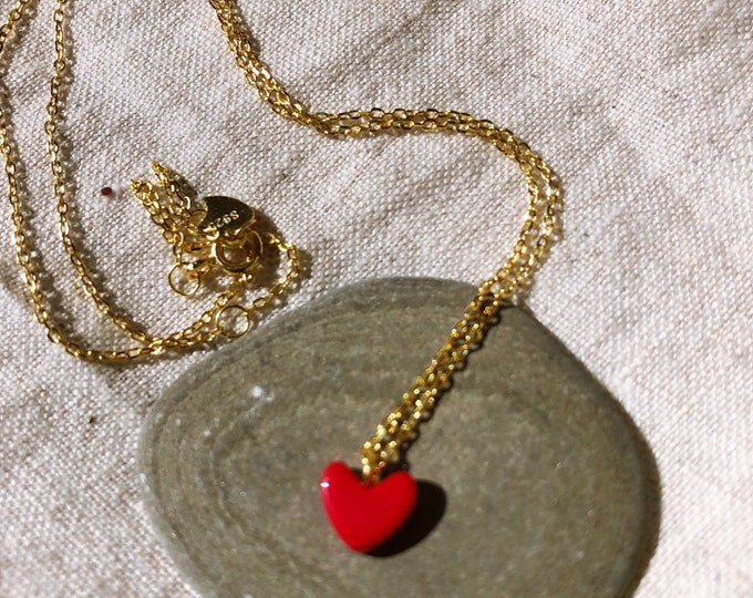 Chain with red heart pendant