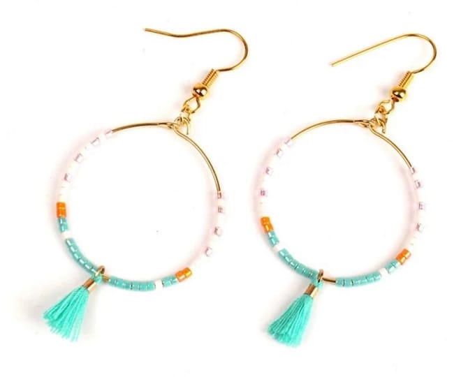 Delicate hoop earrings with small tassel