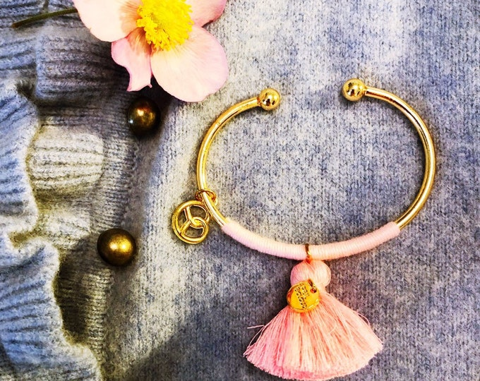 Meadows bangle with pretzels pendant and pink tassel