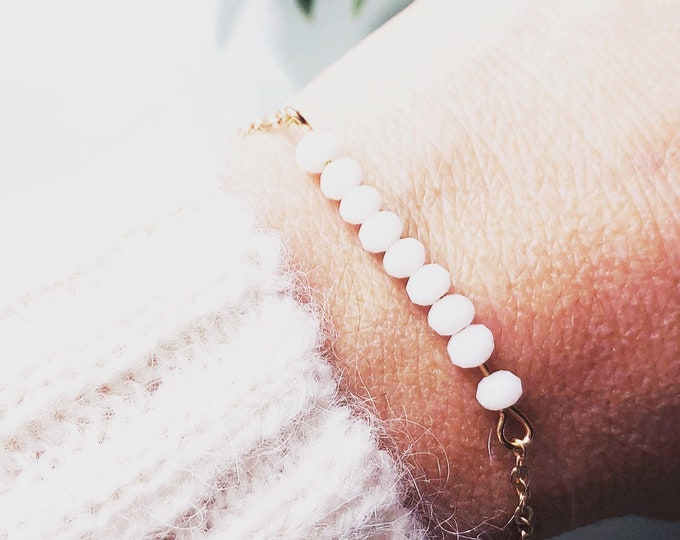 Delicate bracelet with white faceted glass beads