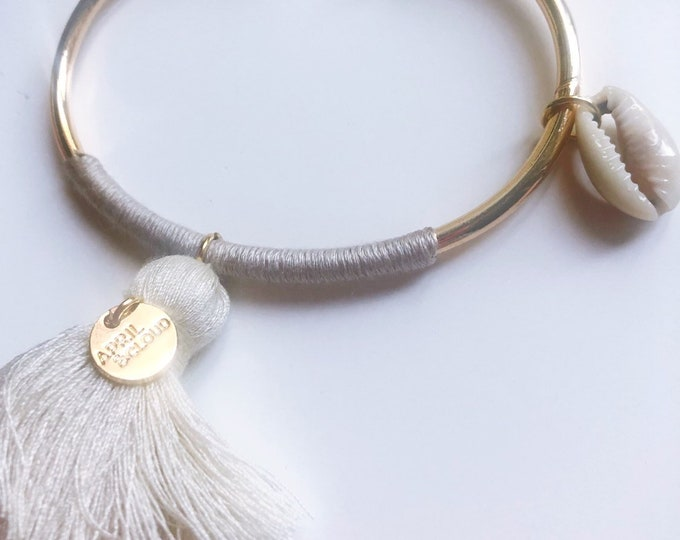 Bangle with tassel and shell charm