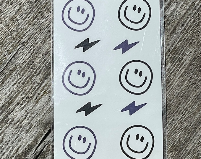 Smile & Blitz Tattoos by April and Cloud