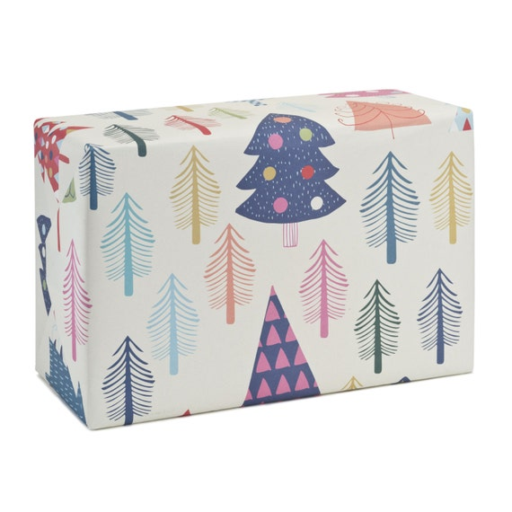 WHITE CHRISTMAS. Christmas wrapping paper. White background. Creative, minimalist, nordic style. Bright coloured trees. Eco gift wrap