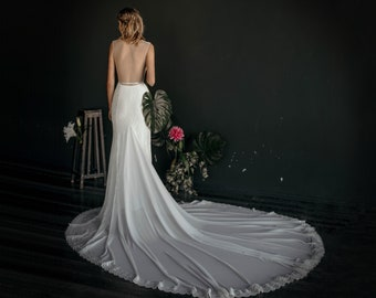 "Elegant lace wedding dress ""Ka Lani"", modern mermaid wedding gown with open back and high round neckline, trumpet silhouette with long train"