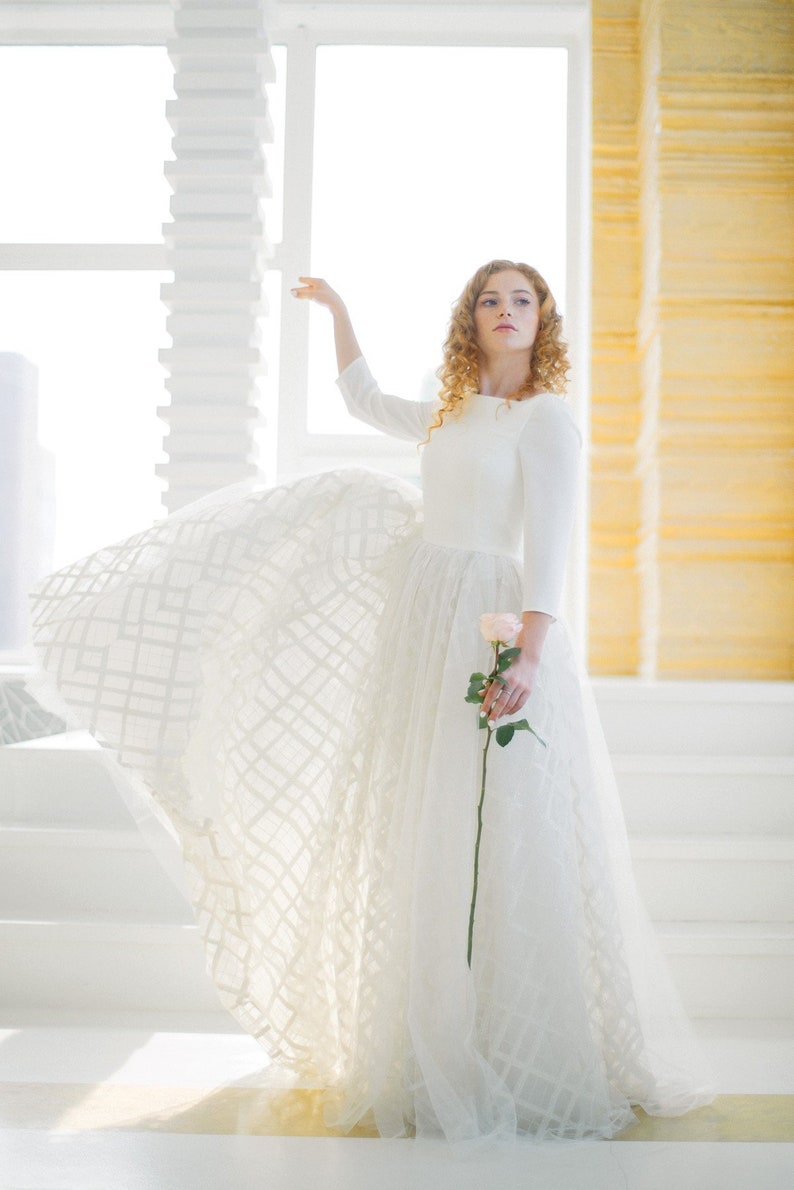 Ethereal Wedding Dress.Eir Long Sleeved Ethereal Wedding Dress With Checked Sparkly Skirt Minimalist Crepe Bodice And Opaque Sleeves Open Scoop Back Milamira