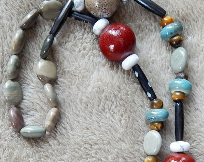 71-75-32. Beaded necklaces for everyone. Take along the only accessory you'll need...
