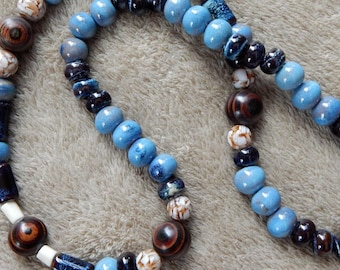 44-48-30. Beaded necklack with ceramic, wood, and bone beads.