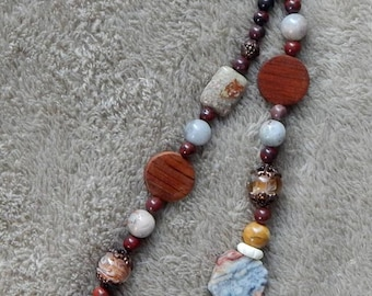 62-68-25.  Simple beaded necklace with red jasper, quartz, copper and glass beads.