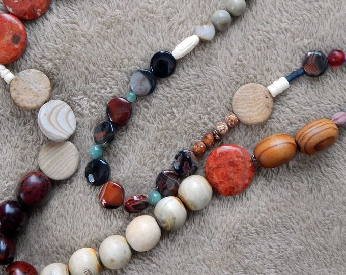 96-00-36. Beaded necklace with bone, glass, wood and ceramic beads.