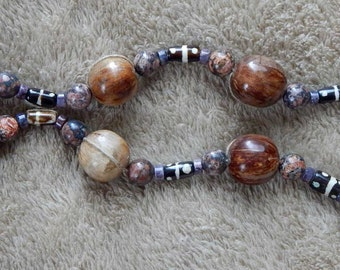 30-40-22. Beaded necklace with seed, bone, ceramic and jasper beads.