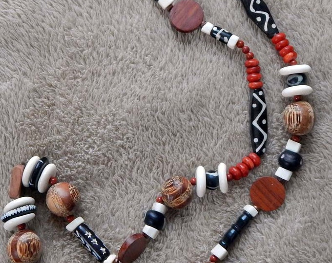 86-93-33. Beaded necklace with African flair.