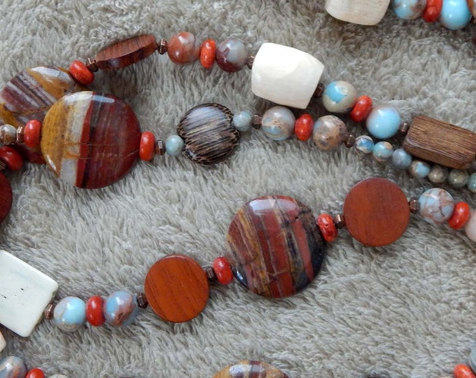 78-83-45. Beaded necklace with clay, bone, ceramic, and seed beads with copper findings.