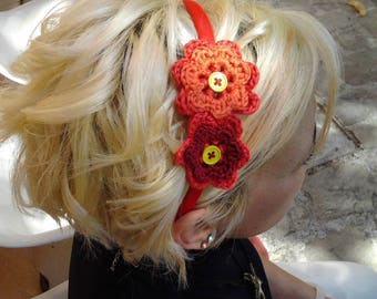 Colored headband, with crocheted flowers and button