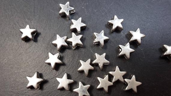 50 kleine Metall-Stern-Perlen silberfarben