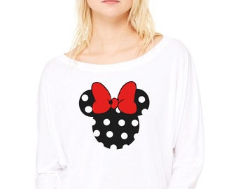 Woman tee with bat sleeves. MINNIE with polka dots and a bright red or animal print ribbon