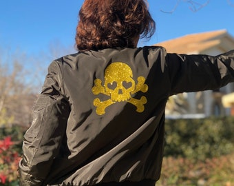 Ladies' bomber jacket with glitter skull at the back