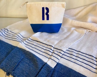 Pack toiletry or accessories bag and pareo towel, personalized.