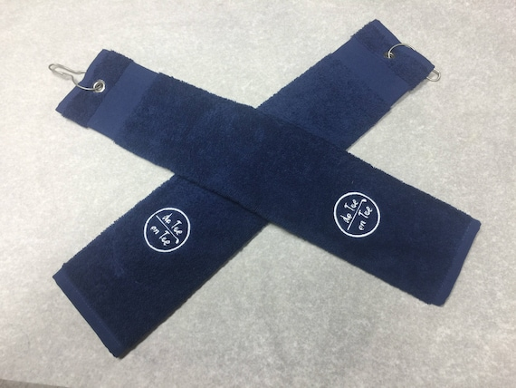 With central opening golf towel. Logo embroidery.