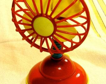 toy fan, bright plastic, battery operated fan