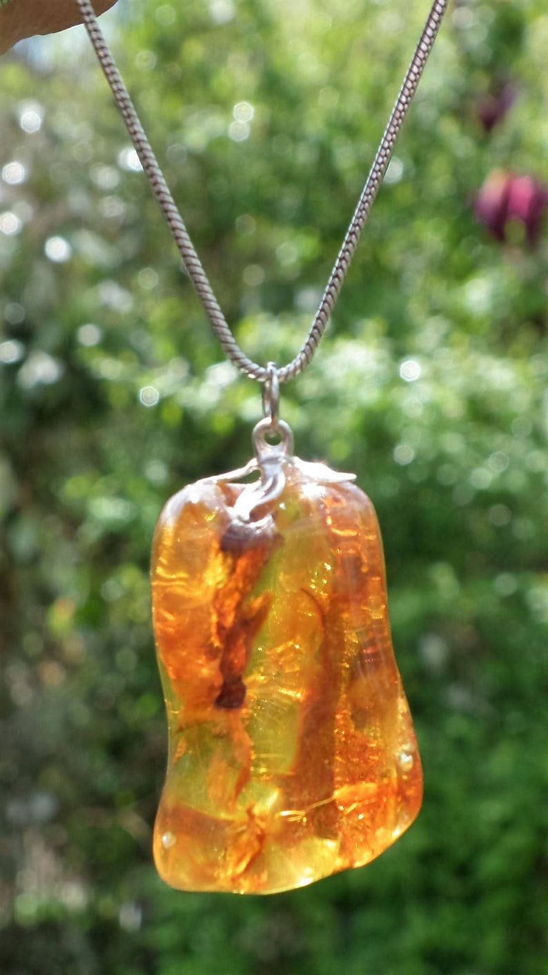 Baltic amber  bernstein pendant with silverplated bel cap