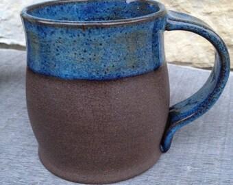 Rutile blue and unglazed raw clay wheel thrown pottery mug