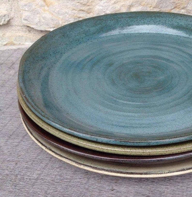 Handmade pottery small plates and bowls... Set of four each image 0