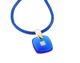Dark blue resin pendant and diamonds