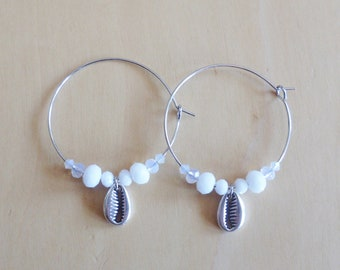 White hoop earrings with silver cowrie