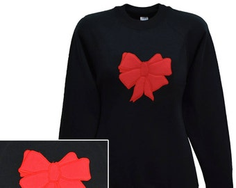 Women's black sweatshirt with embroidered bow design.   Individually made in England.  W10