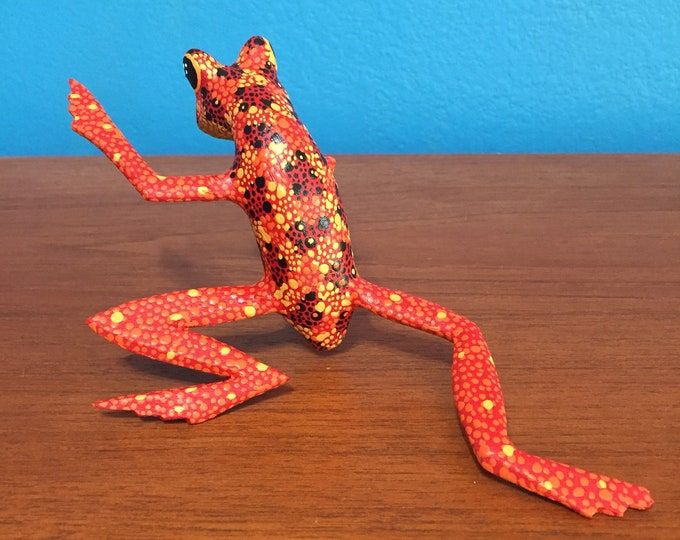 Hand carved wood red and orange Alebrije frog