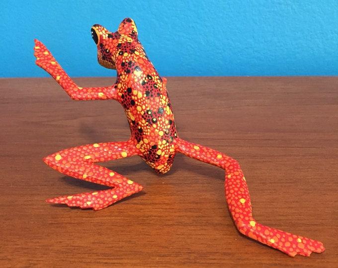 Hand carved wood red and orange Alebrije frog