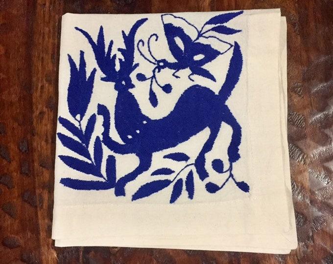"Otomi hand embroidered 19"" x 19"" muslin napkin with blue spirit animal"