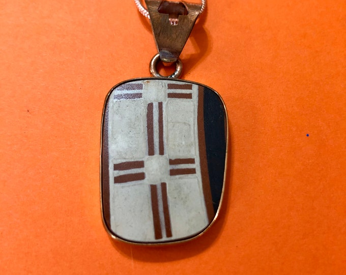 One of a Kind Mata Ortiz pendant - ceramic pottery shard set in 100% pure copper handcrafted setting.