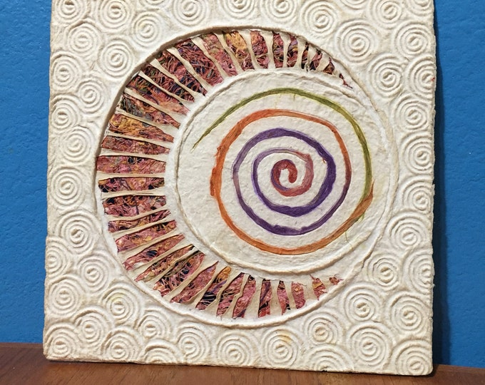 Handmade Amate Paper Wall Art with multicolor woven moon and spiral