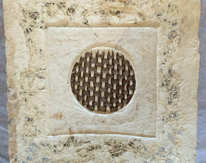 Handmade Amate Paper Wall Art with intricate natural tone woven circle