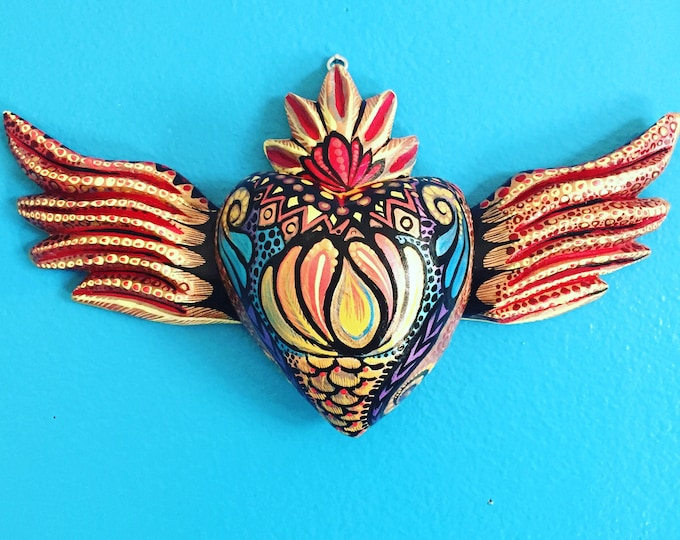 Hand-carved wood milagro heart from Oaxaca, Mexico