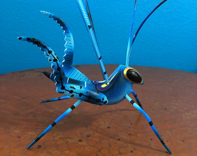 Alebrije Blue Grasshopper Handcrafted Wood Carving by Zeny Fuentes & Reyna Piña from Oaxaca, Mexico.