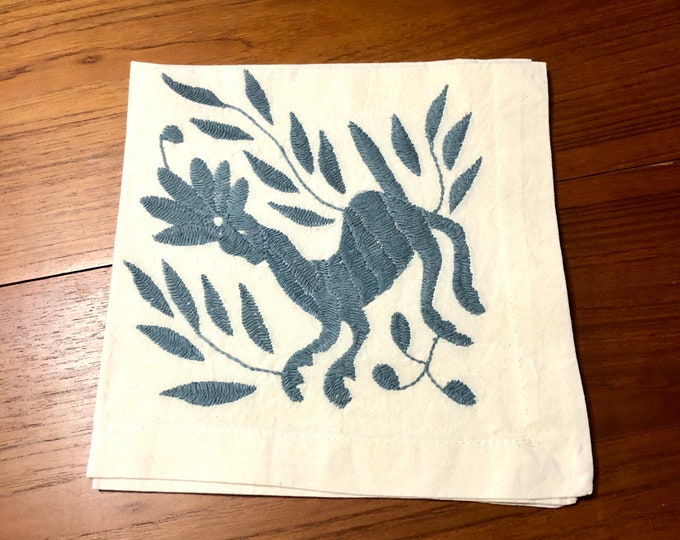 "Otomi hand embroidered 19"" x 19"" muslin napkin with shadow blue spirit animal."