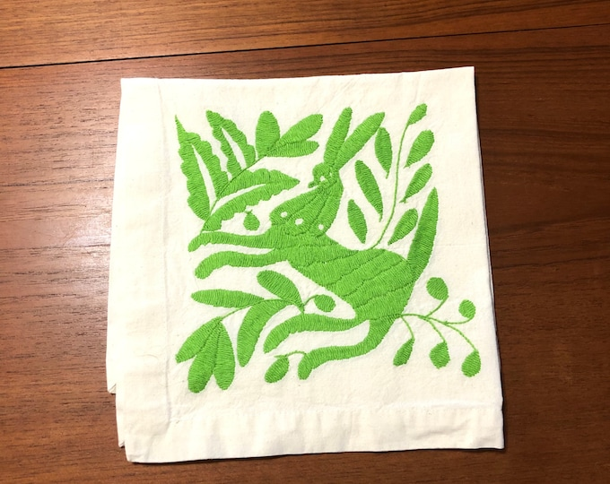 "Otomi hand embroidered 19"" x 19"" muslin napkin with lime green spirit animal."