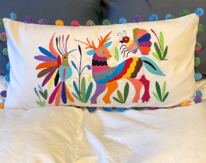 Otomi hand embroidered decorative pillow with bird, bee and spirit animal.
