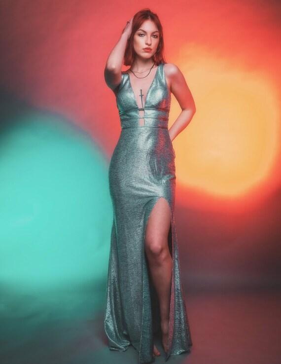 Metallic silver formal gown by Blondie Nites