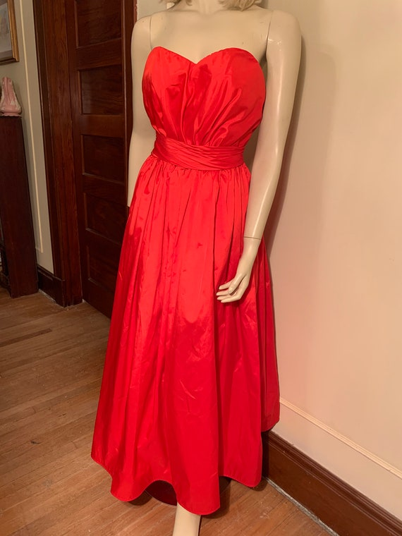 Red strapless gown alyce designs