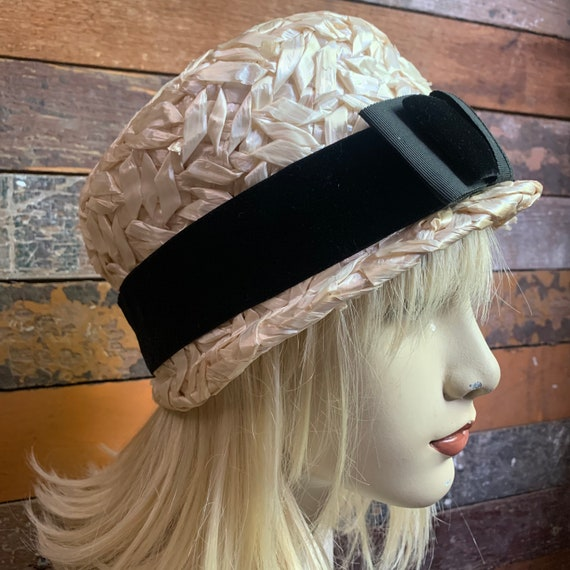 Ivory straw hat with black velvet ribbon