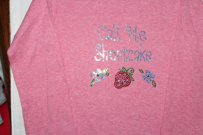Cute One of a kind INVENTORY REDUCTION Sale!!Bling Long Sleeve Onesie They Call Me Shortcake