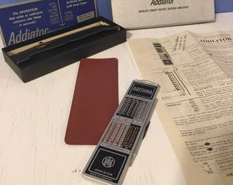 Addiator Arithma pre-1968 mechanical metal adding calculator pre tech cool with original box,instructions and vinyl pouch Excellent cond