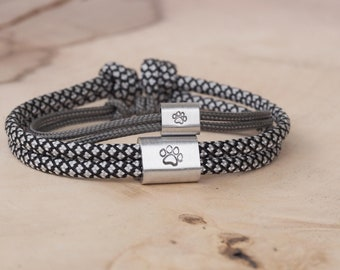 Father son bracelets with different motifs, for example bear, shark, dog paw or anchor